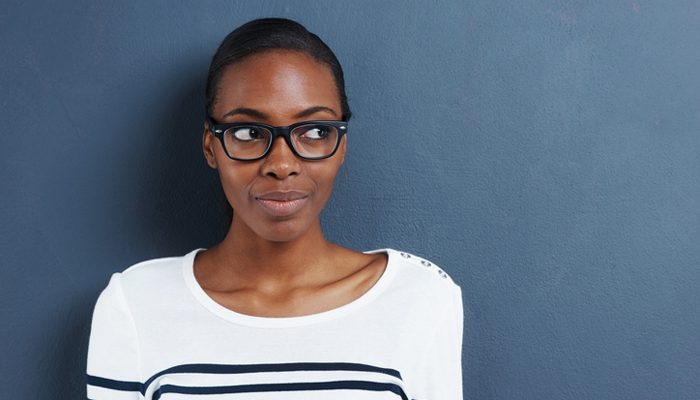 thoughtful woman in glasses