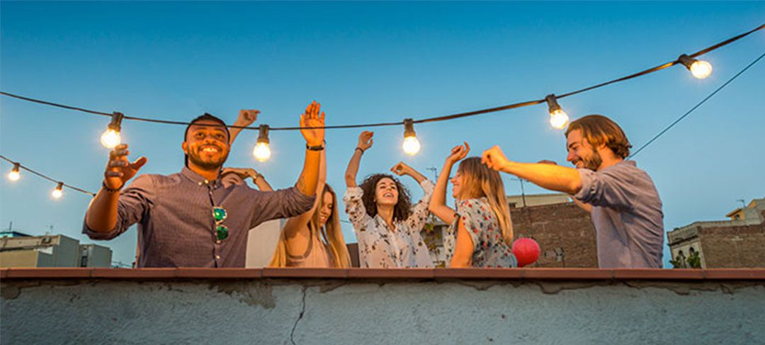 Group of students dancing on rooftop